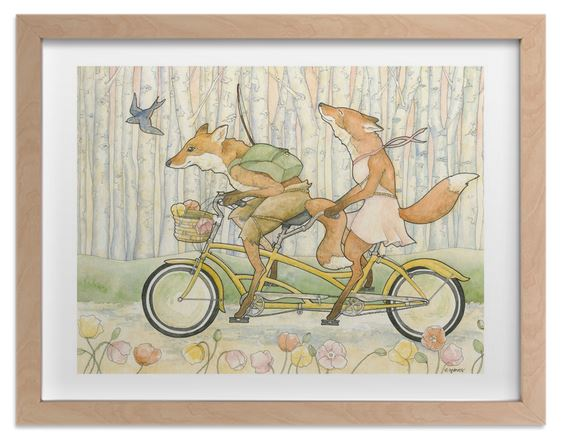 Look! Foxes riding a bicycle built for two!